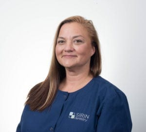 Carrie, Dr. Sirin's dental assistant