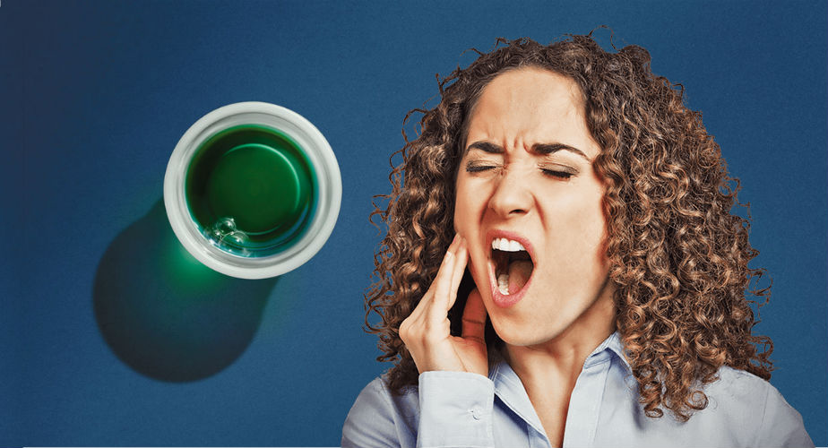 woman with toothache and Nyquil cup