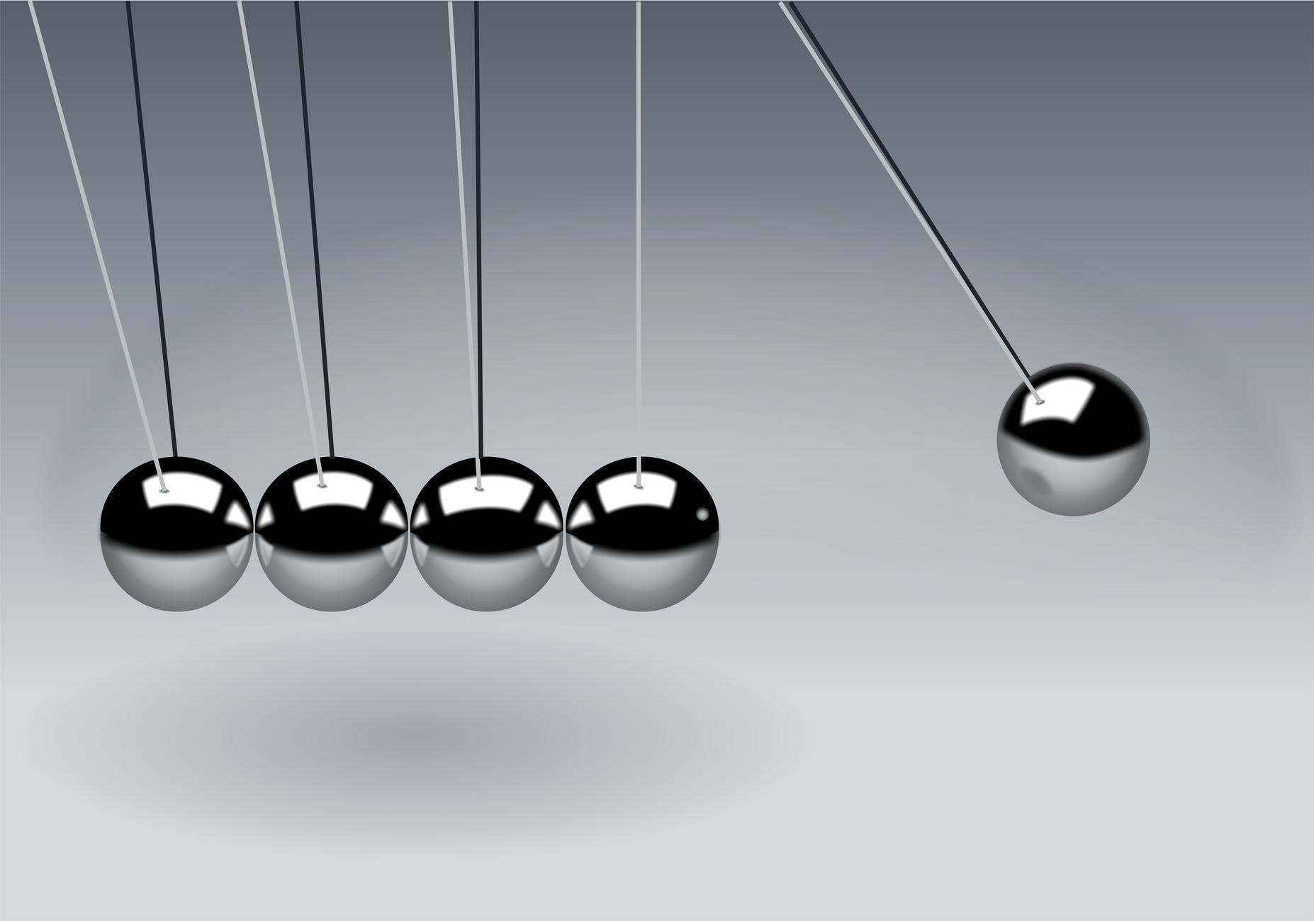 newtons cradle balls to demonstrate dental implant movement